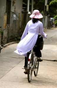 woman cyclist in Mekong Delta village